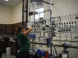 "Jenn Santoro '11 inserts samples into the ""dirt burner."""