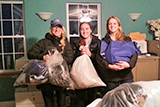 From left, Assistant Women's Lacrosse Coach Nora Fallon-Oben, captains Margaret Gabriel '16 and Caroline McCarthy '16 with donations for the Rescue Mission.