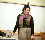 Author Lauren Magaziner '12 gets into the spirit of her book <em>The Only Thing Worse Than Witches</em> in her talk at Hamilton.