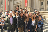 New York City Program students and Professor Dan Chambliss on the steps of the Metropolitan Museum of Art.