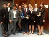Hamilton's 2013-14 Mock Trial team with theri first place award at the University of Rochester Invitational.