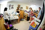 Rachel Pollan '16 makes her bed as Charlotte Beers '16 straightens up in their North Hall room on Aug. 25.