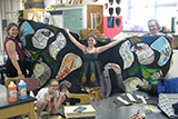 The fashion design group shows off their cape inspired by a butterfly.