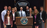 Program in Washington students at the Pentagon with Lt. Col. Eric Hannis '90, center, and professor Sharon Rivera.