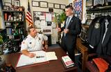 Peter Maher '13, right, talks with Rome deputy police chief Kevin Simons '88.