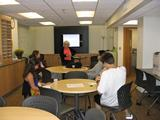 QSR Center director Mary O'Neill talks to students at the new offices.