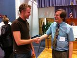 Sam Hincks '11 (left) is congratulated by Karl Wurst, conference co-chair.