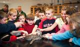 Students from Seneca Street School in Oneida visit with a snake in Prof. Dave Gapp's lab.
