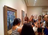 Students in Brent Plate's Religion and Modern Art seminar view Van Gogh's <em>Starry Night</em>.