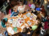 Students color and make paper snow flakes as they participate in a Student Activities big study break in Sadove Center.