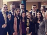 The victorious Mock Trial team  with their Opening Round Championship trophy at Penn State.