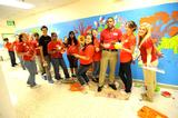Jose Vazquez '15 (blue shirt) paints a mural at a school in Baltimore with his group.