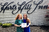 Women's basketball student-athletes Adrianna Pulford '15 and Rachel Fredey '15 with a certificate of recognition from the Oneida County Office for the Aging and Continuing Care as a 2015 Older American Awards Honoree.