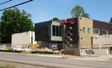 Construction crews finish the stone and terra cotta exterior of the Wellin Museum of Art.