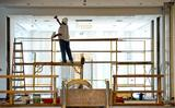Construction workers busy themselves in the new Wellin Museum of Art last week.