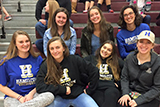 Hamilton volleyball team members at  a Clinton girls' match. Bottom row: Jessica Weston '17, Erin Donahue '18, Kyndal Burdin '18, Claire Kitz '19. Top: Meghan Wilkinson '19, Margaret O'Brien '18, head coach Erin Glaser.