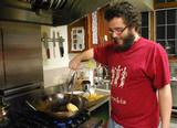 Juancho Hurtado '11 cooks up a meal at the Co-op.