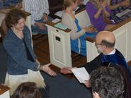 Caroline Davis '11 is congratulated by Dean of Faculty Joe Urgo.