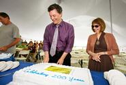 Dean of Faculty Patrick Reynolds and President Joan Hinde Stewart cut one of three birthday cakes for employees.