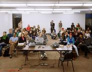 A portrait of an audience at a Cal Arts lecture by Tim Davis.