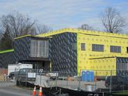 The museum will feature a second-floor classroom over the College Hill Road entrance (at left in photo).