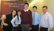 Alumni at Hartford Financial who welcomed Daniel Tempest '13 (center) included, from left, Courtney Mocio '07, Sandra Revueltas '05, David Chen '06 and Steve Prymas '96.