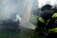The Clinton Fire Department, shown here at a mock dorm room fire, was among recipients of Town-Gown Fund grants.