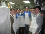 Men's lacrosse team members at the Utica Rescue Mission on Feb. 6