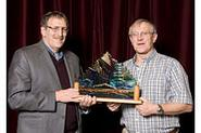 Maurice Isserman (left) accepting award from Mike Mortimer at Banff