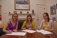 2010 Senior Gift Co-Chairs Julia Pollan '10 and Valerie Valent '10, alongside President Joan Hinde Stewart, sign the 2010 Senior Gift Environmental Sustainability Fund agreement. Not pictured: Senior Gift Co-Chair Megan Bumb '10.