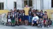 Mike Evans '05 and others playing basketball with boys in Cuba
