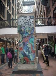 Students view a piece of the Berlin Wall, given as a gift to Montreal.