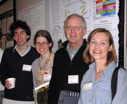 Dan Bruzzese '12, Jen Santoro '11, Prof. Bill Pfitsch and Hilary Smith '98 in front of one of the Hamilton posters.