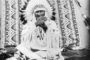 "In a film of the ""Indian Sign Language Council of 1930"" made by the U.S. Department of the Interior, Mountain Chief, a Piegan signer of Plains Indian Sign Language tells a story of buffalo being driven over a bluff."