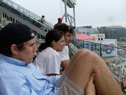 Charlie Warzel '10, Mia Cakebread '10 and Chris Risi '10 watch the baseball action.