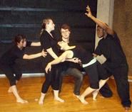 The cast of In The Watchfires rehearses a scene for the May 12 performance.