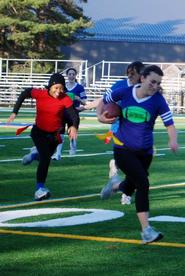 Phi Beta Chi's Julia Weis '12, (blue), gets ready to score with Sigma Lambda Upsilon's Laura Lee Smith '11 (red) in hot pursuit.