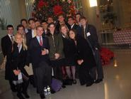 Students in Washington Program at the international Christmas tree in the atrium of the World Bank.