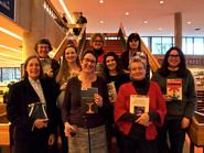 Female faculty authors were honored at a book party.