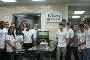 Hamilton students gather in the Bowery Mission kitchen with Prof. Erol Balkan.