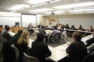 Charter Trustees Bob Delaney '79 and John Rice '78 talk with Chinese concentrators.