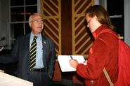 Dr. James Cobey '65 talks with Elizabeth Parker-Magyar '12.