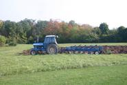 Local farmer Ed Crane used his equipment to turn over the garden's ground.