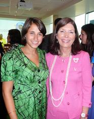 Rachel Pohl '11, left, and President of Walt Disney World Resort Meg Crofton at the August 13