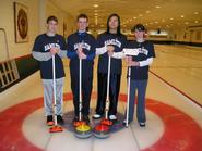 Champion curlers Dave Hamilton, Tom Irvin, Yuqi Mao, Katherine Alser