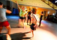 From left: Jessica McBeck '12, Claire Zurlo '14 and Grace Belkot '12 dance during the marathon to benefit Clinton ABC House.