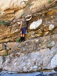 Alex De Moor poses at the base of the Ediacara Period.