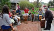 Students and Professor Lydia Hamessley demonstrate Ewe drumming.