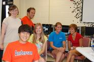 Natalia Connolly, back left, with Jeff Rodriguez and his physics students.