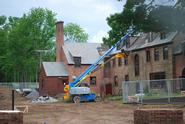 Workers remove the roof from the back of Emerson Hall